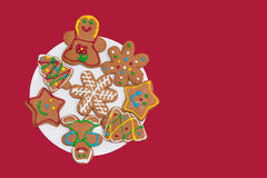 Colorful gingerbread cookies on a white plate Royalty Free Stock Images