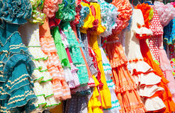 Colorful gipsy dresses in rack hanged in Spain. Colorful gipsy flamenco dresses on rack hanged in Spain market Royalty Free Stock Photo