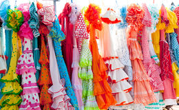 Colorful gipsy dresses in rack hanged in Spain Royalty Free Stock Photos