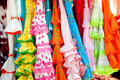 Colorful gipsy dresses in rack hanged in Spain. Colorful gipsy flamenco dresses on rack hanged in Spain market Royalty Free Stock Image