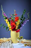 Colorful  gladioluses. Still life with colorful  gladioluses and fresh fruits Stock Photos