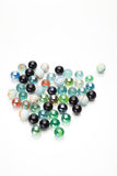 Colorful glass balls. Colorful glass cat-eye marbles on a white background Stock Photos