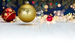 Glass balls on blurred christmas lights background with fir bran Royalty Free Stock Image