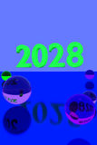 Colorful glass balls on reflective surface and the year 2028. 3D rendering of colorful glass balls on reflective surface and the year 2028 in big numbers Stock Photography