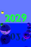 Colorful glass balls on reflective surface and the year 2029. 3D rendering of colorful glass balls on reflective surface and the year 2029 in big numbers Royalty Free Stock Photo