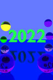Colorful glass balls on reflective surface and the year 2022. 3D rendering of colorful glass balls on reflective surface and the year 2022 in big numbers Stock Photos
