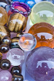 Colorful glass balls on a sunny day. Collection of colorful glass balls with reflection, Panjiayuan market, Beijing, China Stock Photo