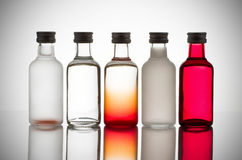 Colorful glass bottles. Back lit collection of colorful glass bottles Stock Images