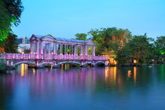Colorful glass bridge on the lake Royalty Free Stock Image