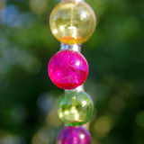 Colorful glass bulbs. Colorful vitreous bulbs. Lamps on wire Stock Photography