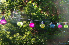 Colorful glass bulbs. Colorful vitreous bulbs. Lamps on wire Royalty Free Stock Image