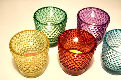 Colorful glass. And candle decoration royalty free stock photo