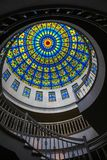 Colorful glass ceiling window inside big cathedral church on top of the roof stock photography