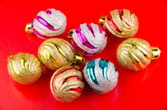 Colorful glass Christmas tree balls on red background Royalty Free Stock Photography