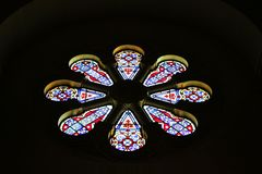Colorful glass church window in darkness Royalty Free Stock Photos