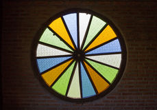 Colorful glass circle on brick wall Stock Image