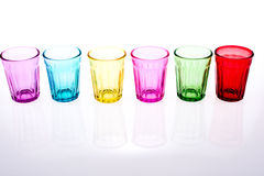 Colorful glass. Colorful drinking glass lined up on white background Stock Image