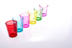 Colorful glass. Colorful drinking glass lined up on white background Stock Photos