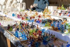 Colorful glass figures on a christmas market booth in merano, south tyrol in italy during daylight stock photography
