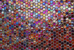 Colorful glass gemstones in a wall. Wall decorated by glass gems Royalty Free Stock Photos