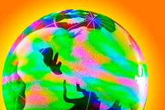 Colorful glass globe with shining Stock Photos