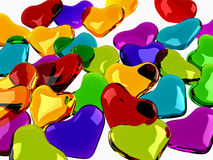 Colorful glass hearts background. Colorful glass hearts on grey background,transparency,reflection and refraction Stock Photo
