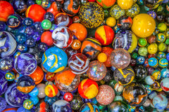Colorful glass marble multicultural community concept. Colorful Glass marbles of different sizes in a color pattern as methaphor for multicultural community Royalty Free Stock Photos