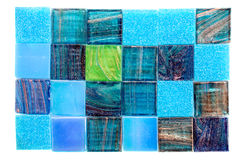 Colorful glass mosaic tiles aligned on white Royalty Free Stock Images