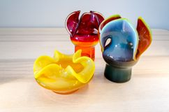 Polish mid century design, vases. Colorful glass vases and ashtray. Polish mid-century design this kind of vases used to be called `osiołek` - `donkey` nobody Stock Photo