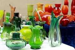 Colorful glass vases at the flea market Stock Photos