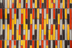 Colorful glass vertical rectangular tiled wall background. Multicolored tiles Royalty Free Stock Photography