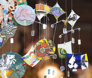 Colorful glass wind chime hanging. Outside, shallow focus Royalty Free Stock Photos