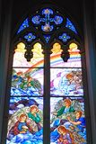 Colorful glass window in a church Stock Images