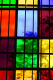 Colorful Glass window. S with grid in church stock photo