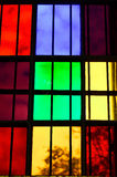Colorful Glass window. S with grid in church royalty free stock image