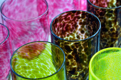 Colorful Glass-work cups background Stock Images