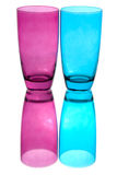 Colorful glasses. Pink and blue glasses in front of white background Royalty Free Stock Photography
