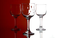 Colorful glasses. Three glasses in front of white, red background Stock Photo
