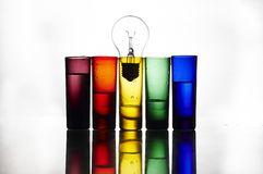 Colorful glasses and bulb Royalty Free Stock Images