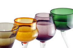 Colorful glasses in a row. Colorful cocktail or shot glasses in a row Royalty Free Stock Images