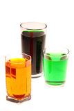 Colorful glasses. Colorful water in the glasses Stock Images