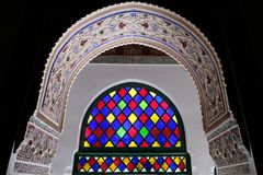 Colorful glass window and exquisite decoration in bahia palace in morocco. Colorful glaze light reflection at the interior of Bahia palace in Marrakech. very Stock Photos
