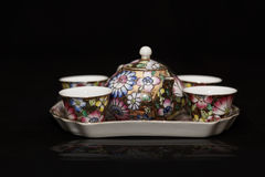 Colorful glazed antique porcelain tea set Stock Photo