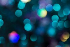 Colorful glitter abstract background with bokeh. Defocused lights christmas stock illustration