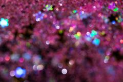 Colorful glitter abstract background with bokeh. Defocused lights christmas vector illustration