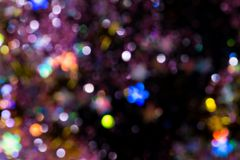Colorful glitter abstract background with bokeh. Defocused lights christmas royalty free illustration