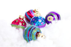 Colorful glitter Christmas balls over white background Stock Images
