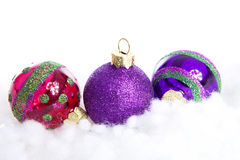 Colorful glitter Christmas balls over white background Stock Photo