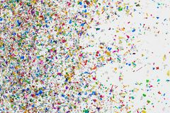 Colorful glitter and confetti on white background stock photography