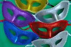 Colorful glittery masks Stock Photos